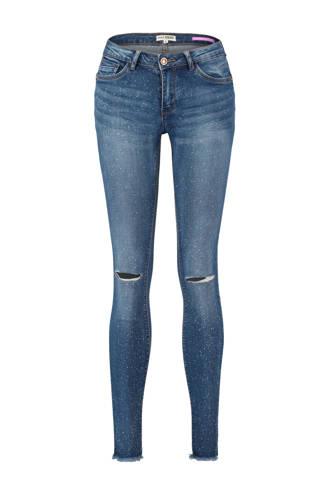skinny jeans met all over verfspatten