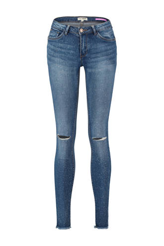 skinny jeans met all over verfspatten