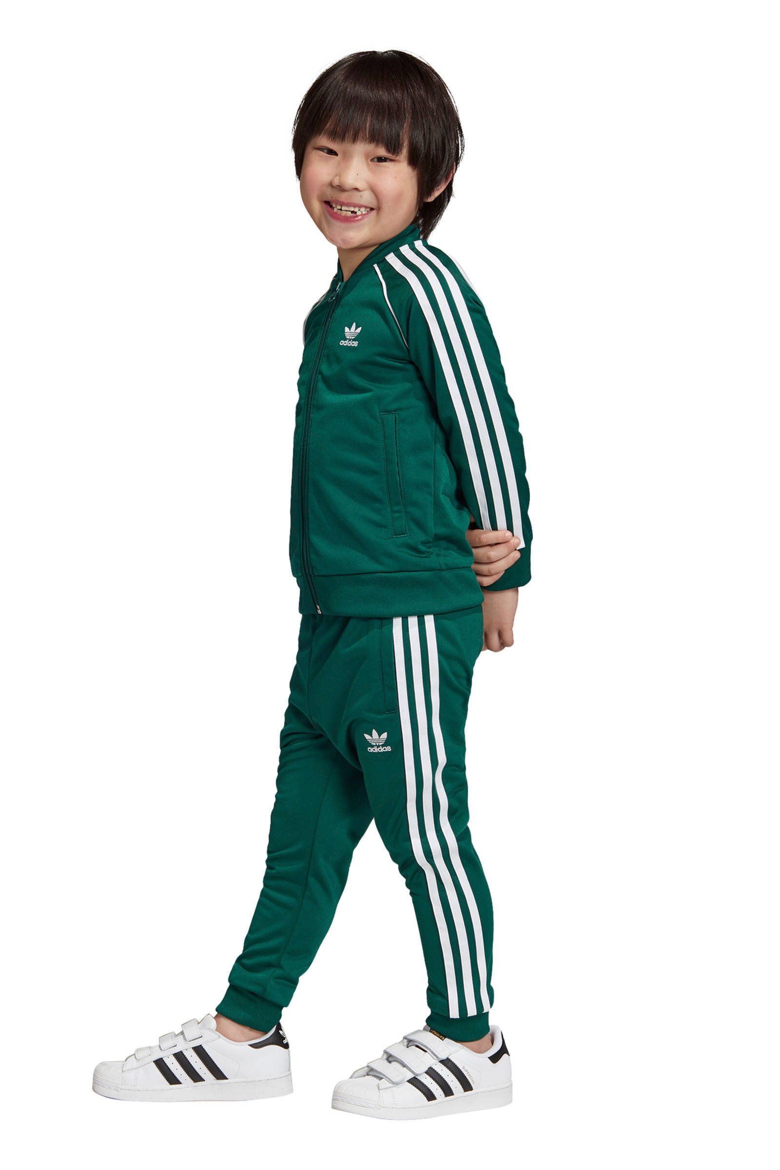 adidas Originals Adicolor trainingspak groen | wehkamp