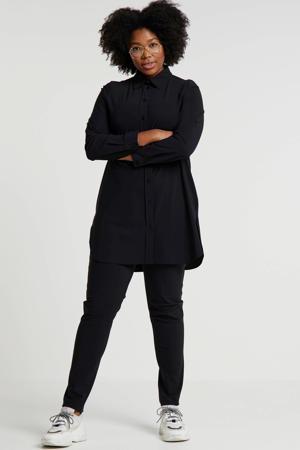 blouse van travelstof zwart