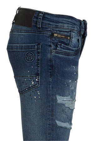 skinny jeans met slijtage blauw