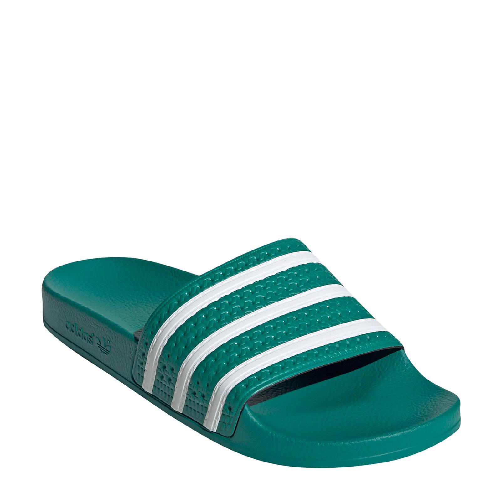 adidas Originals Adilette badslippers groen/wit | wehkamp