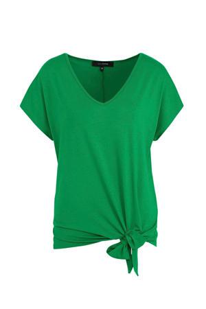 top met knoopdetail groen