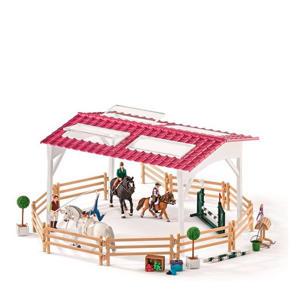 ruiterschool met ruiter en paarden