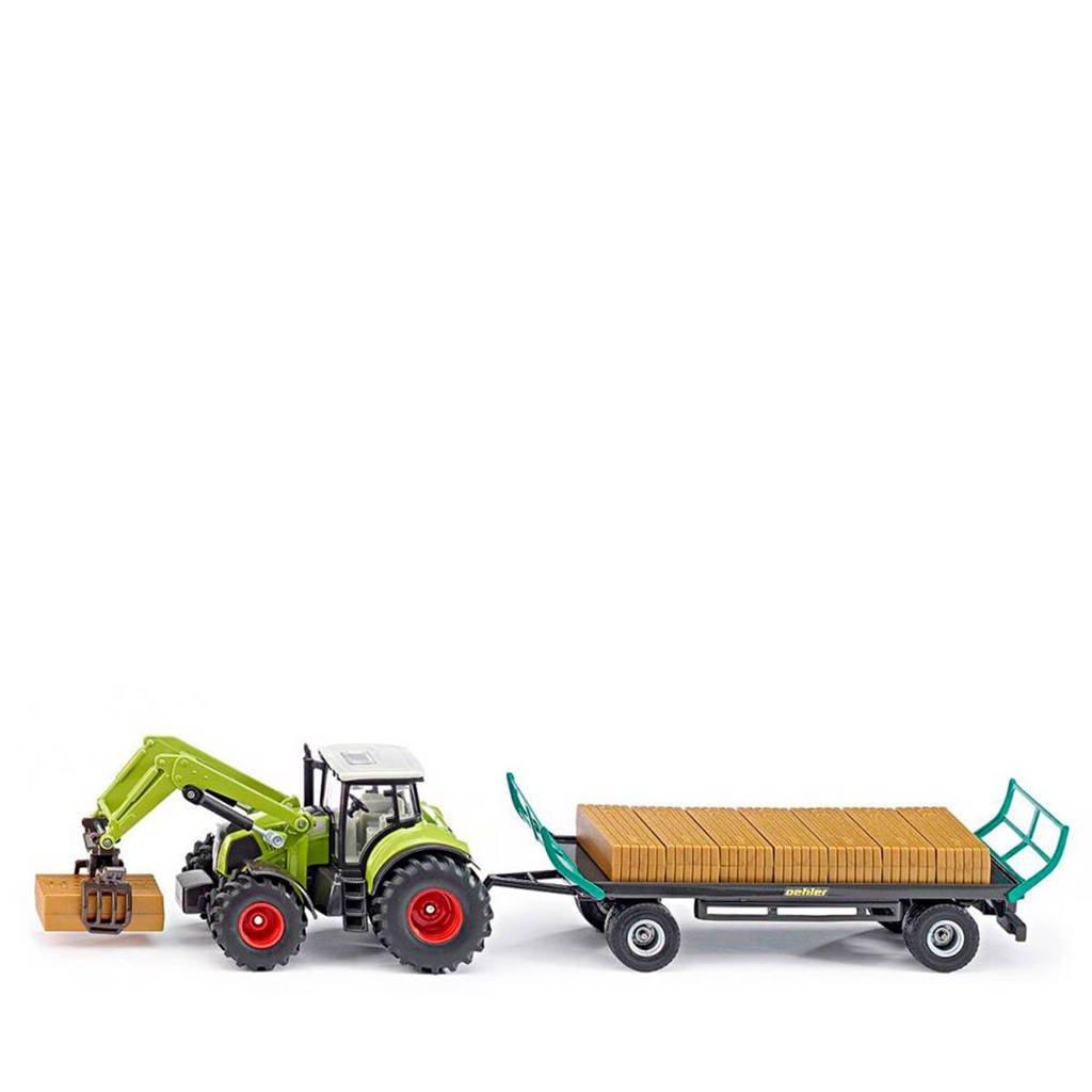 Mayka  tractor met balengrijper en aanhanger