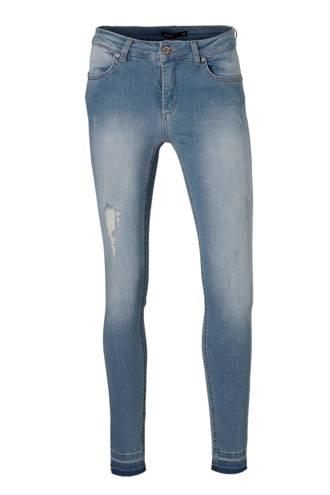 skinny jeans met destroy